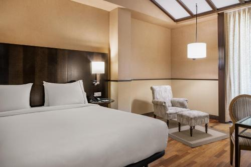 A bed or beds in a room at AC Hotel Ciudad de Tudela