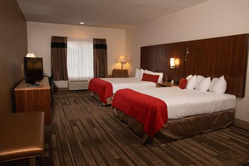 A bed or beds in a room at Northfield Inn Suites and Conference Center