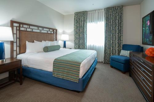A bed or beds in a room at Tahiti All-Suite Resort