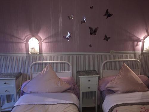 Un ou plusieurs lits dans un hébergement de l'établissement Domaine Jeanne d'Arc