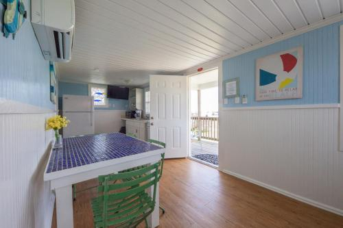 A kitchen or kitchenette at Blue Dolphin Inn and Cottages