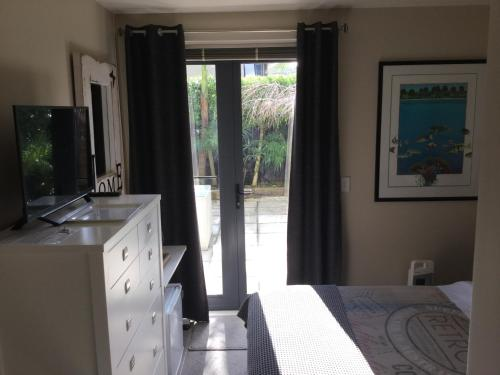 A television and/or entertainment center at Parnell one bedroom with ensuite