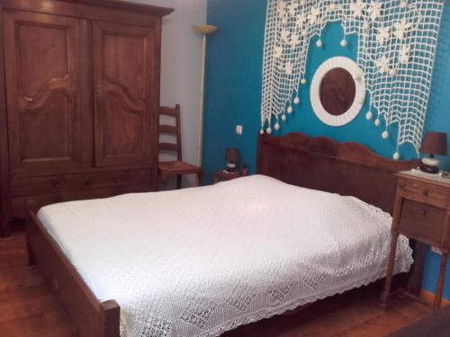 A bed or beds in a room at Vosges Chambres d'hotes