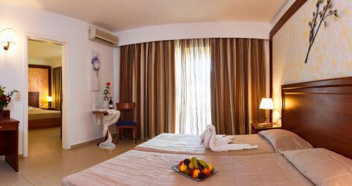 Cama o camas de una habitación en Gaia Royal