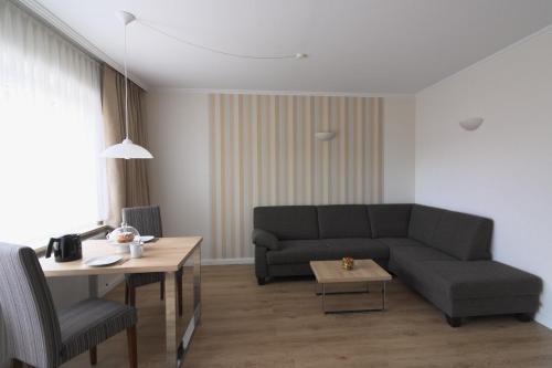 Ein Sitzbereich in der Unterkunft Ferienwohnungen Reimann