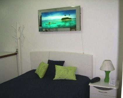A bed or beds in a room at Flats na Barra