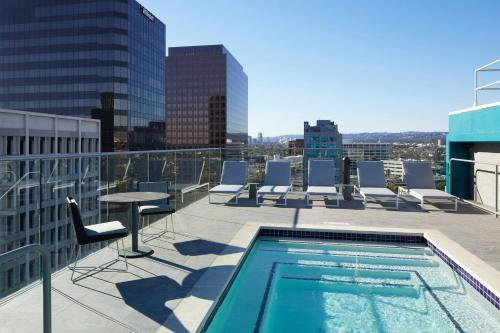 The swimming pool at or close to AC Hotel by Marriott Beverly Hills
