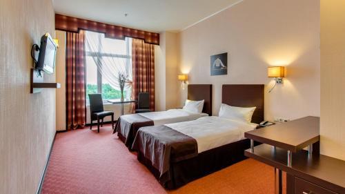 Кровать или кровати в номере Отель Инсайд Бизнес Румянцево