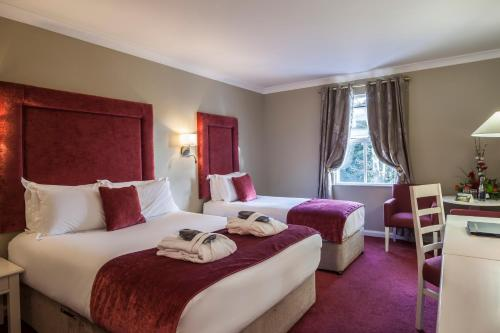 A bed or beds in a room at Roganstown Hotel & Country Club