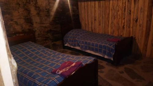 A bed or beds in a room at Jurkha's Shatili Tower