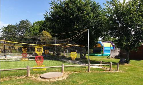 Children's play area at Camping la Roseraie d'Omaha