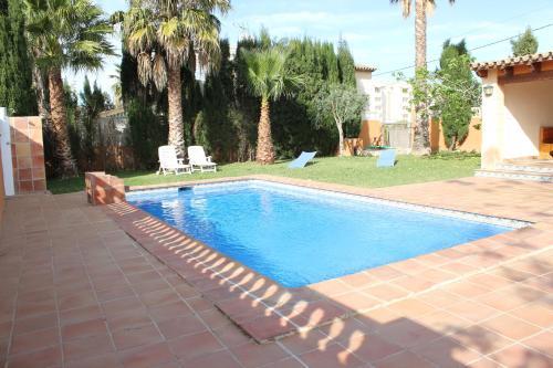 The swimming pool at or near Villa Almendros