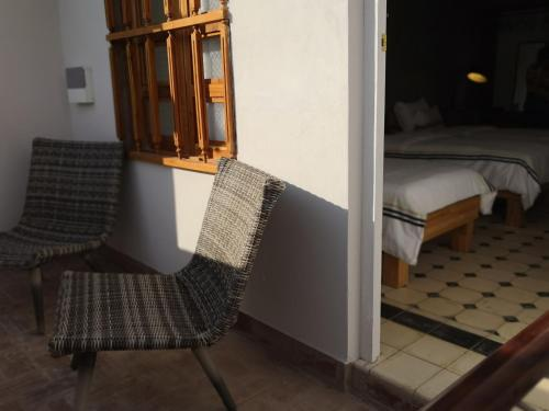 A bed or beds in a room at Casa Zenia Ana