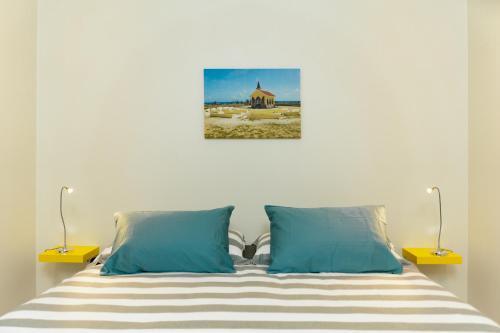 Cama ou camas em um quarto em Hideout Suites - from Eagle Beach