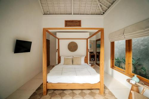 A bed or beds in a room at Villa Madita Lombok