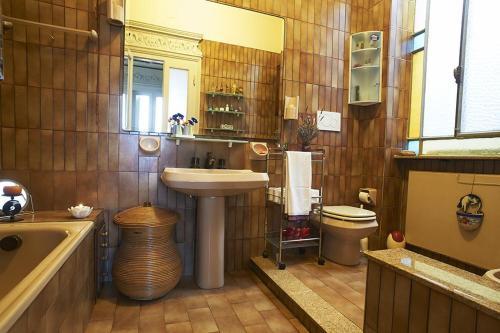 Ein Badezimmer in der Unterkunft Butterflys b&b suite home