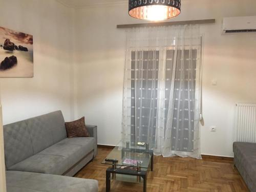 A seating area at Renovated apartment, 1' to metro st. Panormou