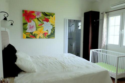 Cama ou camas em um quarto em Villa Serenity