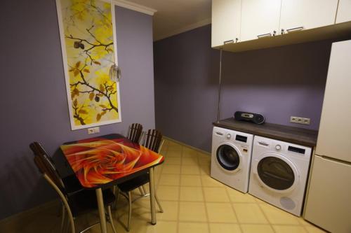 A kitchen or kitchenette at Seasons Hostel