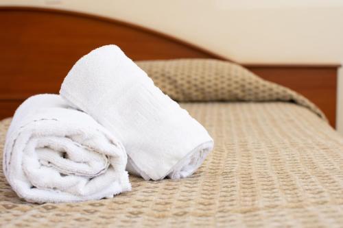 Ένα ή περισσότερα κρεβάτια σε δωμάτιο στο Bintzan Inn Hotel
