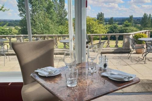 A restaurant or other place to eat at Cricklade House Hotel, Sure Hotel Collection by Best Western