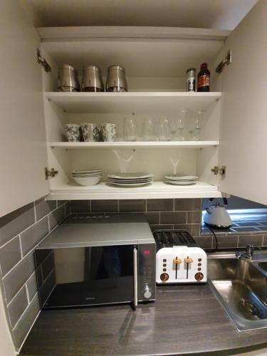 A kitchen or kitchenette at Harvey Apartments