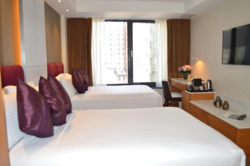 A bed or beds in a room at Concorde Hotel New York