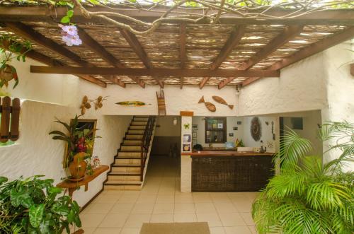 The lobby or reception area at Pousada Borboleta