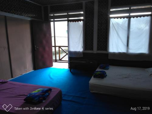 A bed or beds in a room at Rumah Sakinah
