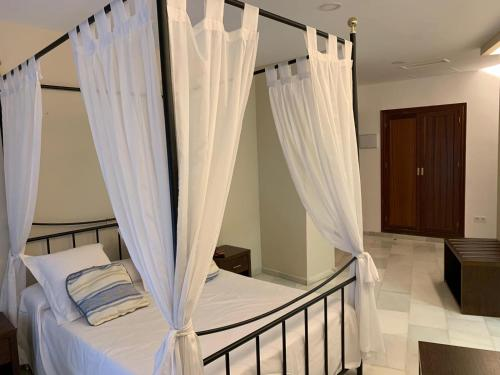 A bed or beds in a room at Nuevo Palas