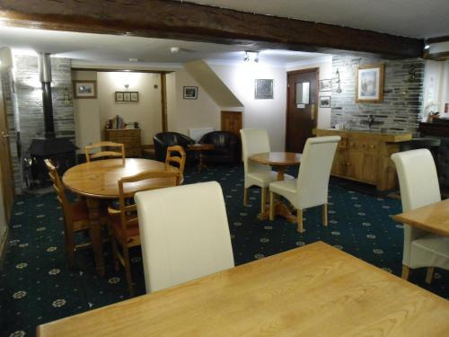 A restaurant or other place to eat at Harvest Home Guest House