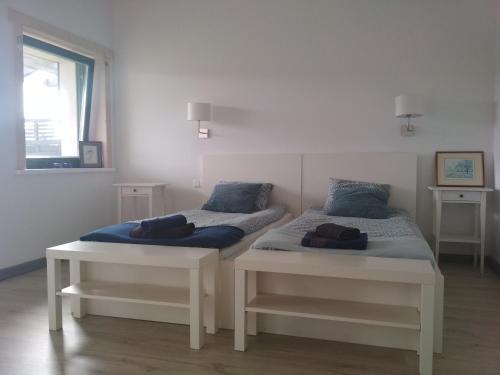 Łóżko lub łóżka w pokoju w obiekcie Chamedafne w Puszczy Kampinoskiej