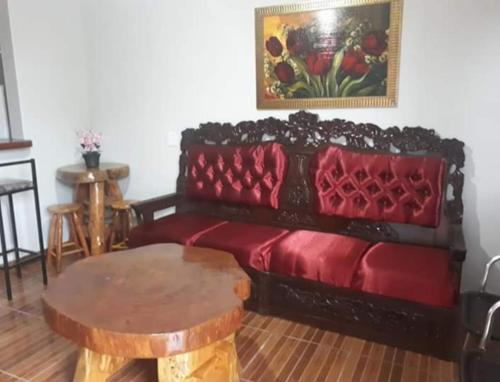 A seating area at Flor Do Ipê Homes