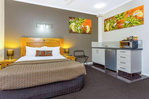 A bed or beds in a room at Quality Hotel Darwin Airport