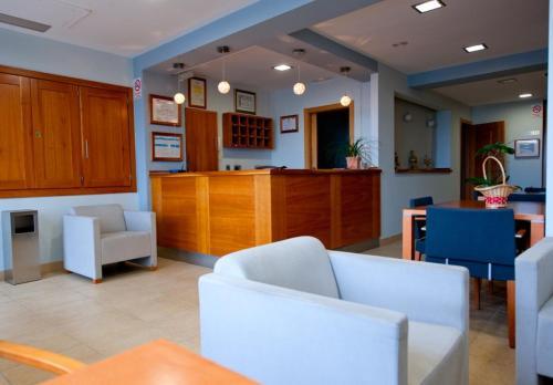 El vestíbulo o zona de recepción de Hotel O Noso Portosin