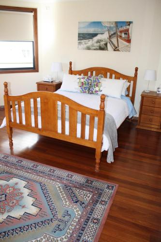 A bed or beds in a room at Serenity on Narrabeen Beach - 1Bdr beachside retreat