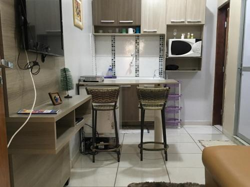A kitchen or kitchenette at Apartamento Duque de Caxias