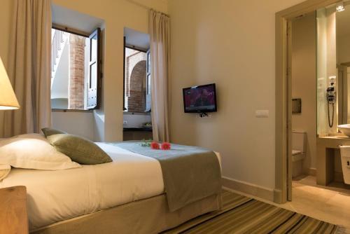 Cama o camas de una habitación en Balcón de Córdoba