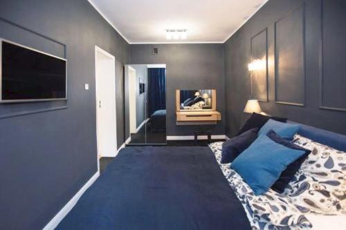 Telewizja i/lub zestaw kina domowego w obiekcie Apartament Młyńska
