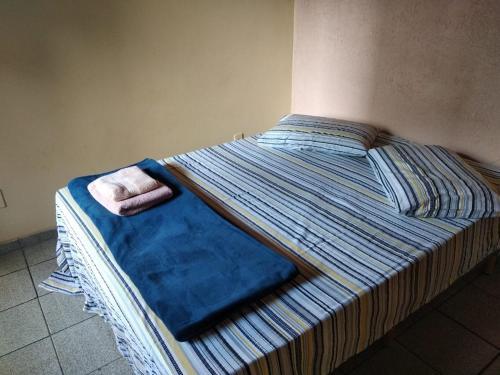 A bed or beds in a room at Recanto da Vovó com Bike