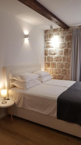 A bed or beds in a room at Apartments Milion