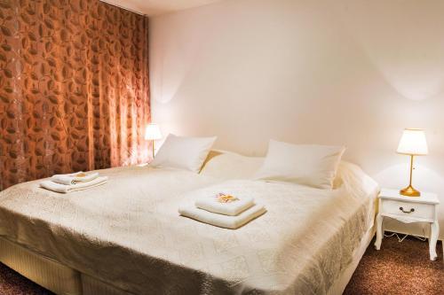 Posteľ alebo postele v izbe v ubytovaní VILLA CENTRUM APARTMÁNY