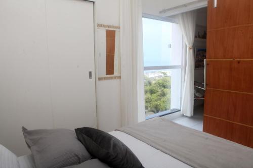 A bed or beds in a room at Encantos do Porto da Barra