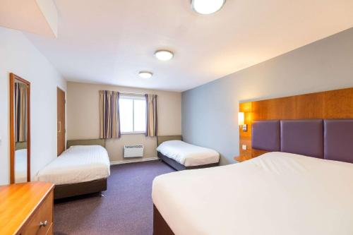 A bed or beds in a room at Comfort Inn Sunderland