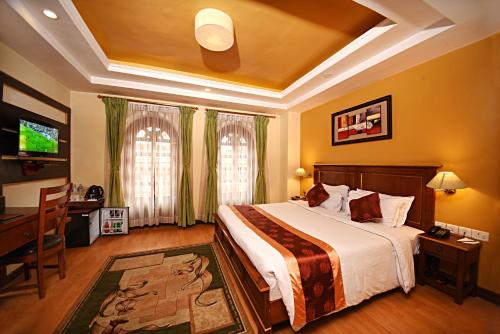 A bed or beds in a room at DOM Himalaya Hotel