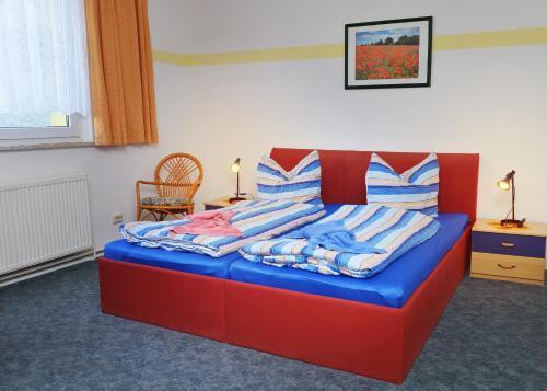 Ein Bett oder Betten in einem Zimmer der Unterkunft Pension Damköhler Thale OT Westerhausen