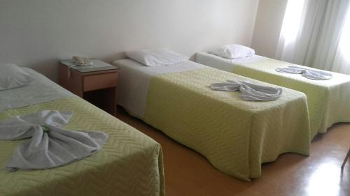 A bed or beds in a room at Hotel di Fratelli