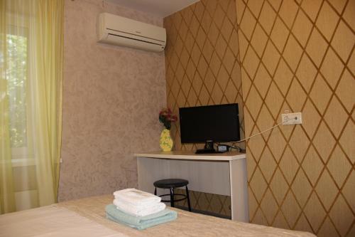 Телевизор и/или развлекательный центр в Hotel Diamant