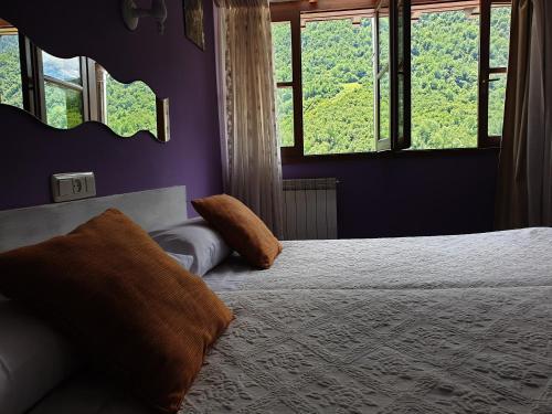 Cama o camas de una habitación en Hotel Gastronómico Arnicio