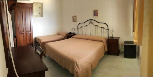 Letto o letti in una camera di Hotel Villaggio Stromboli - isola di Stromboli